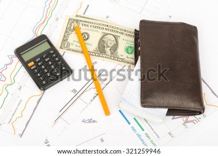 Purse with money and pad on business document background