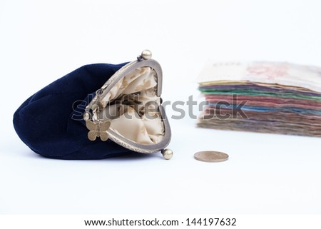 Purse with money isolated on a white backgrounds - stock photo