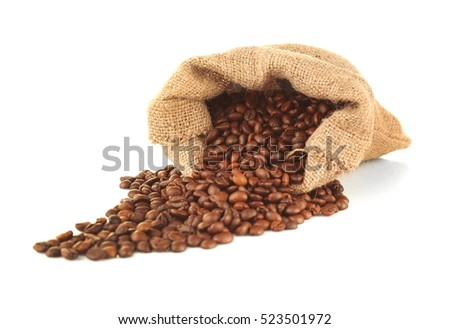Purse with roasted coffee beans isolated on white