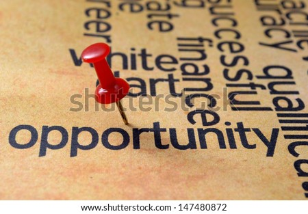 Push pin on opportunity text - stock photo