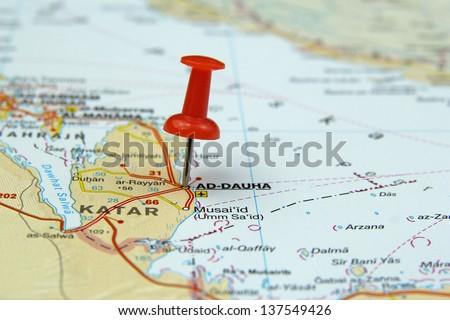 push pin pointing at Doha, Qatar - stock photo
