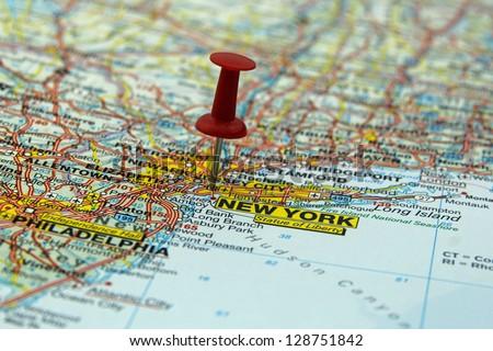 push pin pointing at New York, USA - stock photo