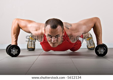 Push up with dumbbells, classic endurance exercise for biceps - stock photo