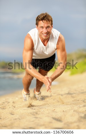Push ups - crossfit fitness man doing clapping push-ups during training exercise workout on beach in summer. Fit male trainer and fitness model exercising intensely outside showing strength and power. - stock photo