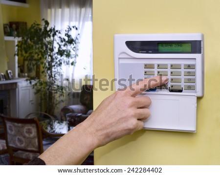 Pushing Alarm. Home security - stock photo