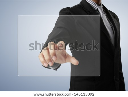 pushing on a touch screen interface - stock photo