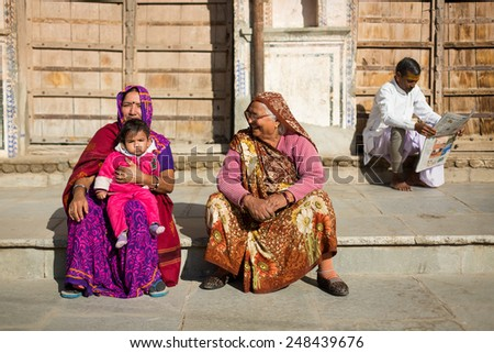 PUSHKAR, INDIA - JAN 08: Family staying on the street of Pushkar on January 08, 2015. Agra is a town in the Ajmer district in the Indian state of Rajasthan.