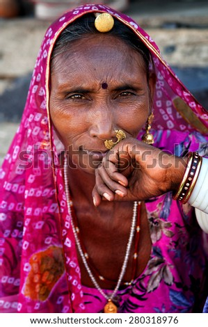 PUSHKAR, INDIA - MARCH 03, 2013: Undefined Indian woman in traditional colourful sari portrait Pushkar, India. March 3, 2013 - stock photo