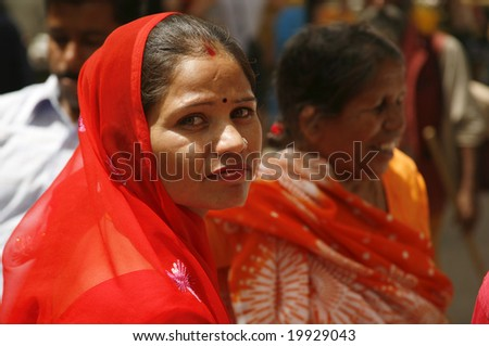 Pushkar, India - May 2008. Portrait of Rajasthani woman during holy Brahmin festival. Pushkar is the only city in India that has a Brahmin temple, attracting Indians from all over the subcontinent. - stock photo