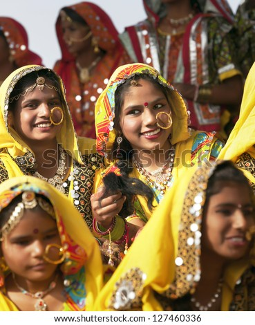 PUSHKAR, INDIA - NOVEMBER 21:  An group of unidentified girls in colorful ethnic attire attends at the Pushkar fair on November 21, 2012 in Pushkar, Rajasthan, India. - stock photo