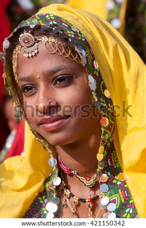 PUSHKAR, INDIA - NOVEMBER 21, 2012 : Portrait of Indian girl in colorful ethnic attire at Pushkar Camel Mela in Rajasthan, India. Pilgrims and camel traders flock to the holy town for the annual fair.