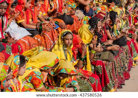 PUSHKAR, INDIA - NOVEMBER 21, 2012 : Portrait of Indian girl in colorful ethnic attire at Pushkar Camel Mela in Rajasthan, India. Pilgrims and camel traders flock to the holy town for the annual fair - stock photo