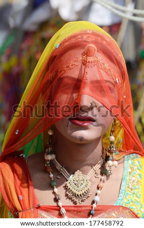 PUSHKAR, INDIA - NOVEMBER 12:Unidentified gay (hijra) dressed as woman at camel fair on November 12,2013 in Pushkar,India.In South Asia culture, hijras are people who have feminine gender identity
