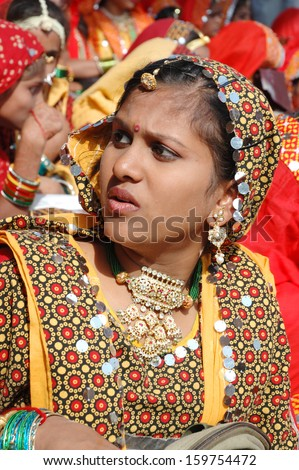PUSHKAR, INDIA - NOVEMBER 21: Young indian woman preparing to dance perfomance at camel festival in Pushkar on November 21,2012 in Pushkar, Rajasthan, India
