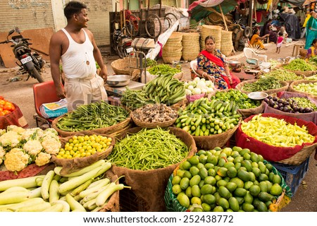 PUSHKAR, RAJASTAN / INDIA - MAY 27 2013 - Unidentified man and woman selling fruits and vegetables on street market. - stock photo