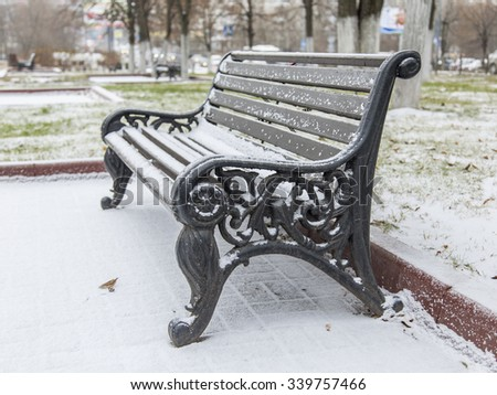 PUSHKINO, RUSSIA, on NOVEMBER 15, 2015. A winter landscape, a bench in the boulevard. A blizzard in the city