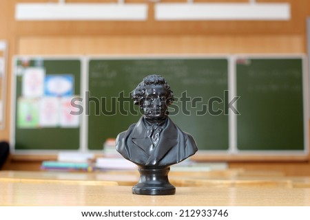 Pushkins sculpture on the desk in a classroom - stock photo