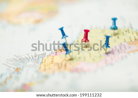 Pushpins on the map of the tourist: travel concept - stock photo