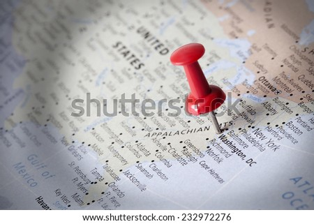 Pushpins with bright light focused on map detail, Important business trip or vacation reminder concept - stock photo