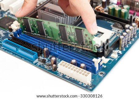 Put computer memory (RAM) in the slot of motherboard - stock photo