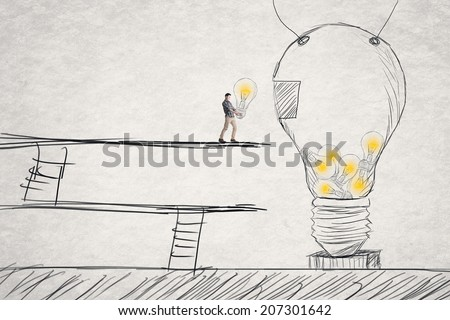 Put small ideas into big one, concept of idea, creation, hard work etc. - stock photo
