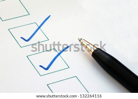 Put the check mark/tick in the boxes concepts of approval and correctness - stock photo