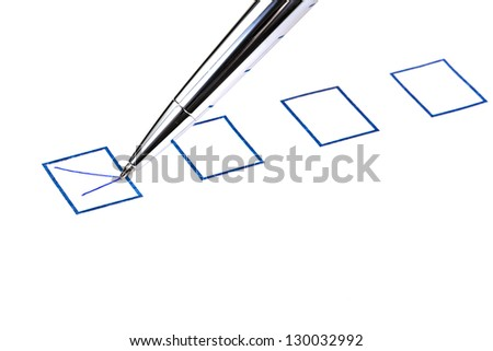 put tick in blue square box by silver pen - stock photo