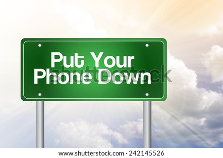 Put Your Phone Down Green Road Sign concept - stock photo