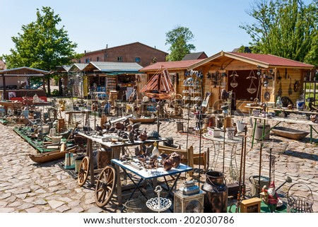 PUTGARTEN, GERMANY - JUNE 22, 2012: Ruegenhof  flea market, a famous marketplace and tourist attraction at Kap Arkona, Island of Ruegen - stock photo