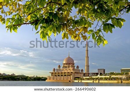 Putra Mosque, Putrajaya at evening during hot day   Image has grain or blurry or noise and soft focus when view at full resolution.  (Shallow DOF, slight motion blur) - stock photo