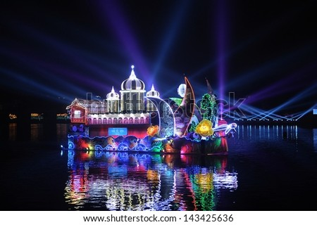 PUTRAJAYA - JUNE 24 : Boat parade called Magic of the Night are shown during Floria Event in Putrajaya, Malaysia in June 24, 2013. - stock photo