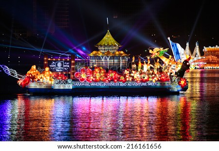 PUTRAJAYA, MALAYSIA- JUNE 21, 2014 :Sarawak floats cruising at lake during FLORIA night show in Putrajaya, Malaysia, showcasing their own unique tourism attraction. - stock photo