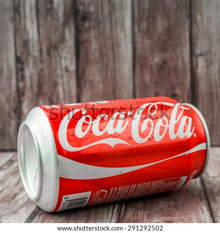 PUTRAJAYA, MALAYSIA - JUNE 28TH, 2015. Coca Cola can on weathered wood. Coca Cola drinks are produced and manufactured by The Coca-Cola Company, an American multinational beverage corporation.