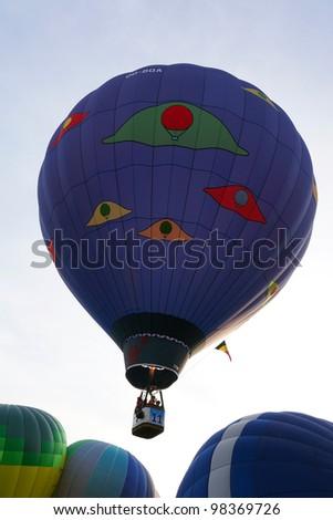 PUTRAJAYA, MALAYSIA - MAR 19 : A hot air balloon from Belgium in flight at the 4th Putrajaya International Hot Air Balloon Fiesta on 19 Mar, 2012 in Putrajaya. 23 balloons participate in this year. - stock photo