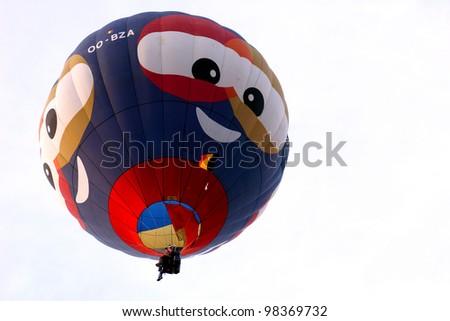 PUTRAJAYA, MALAYSIA - MAR 19 : A hot air balloon from Belgium in flight at the 4th Putrajaya International Hot Air Balloon Fiesta on 19 Mar, 2012 in Putrajaya. 23 balloons participate in this year - stock photo
