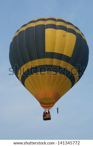 PUTRAJAYA, MALAYSIA - MAR 31 : A hot air balloon from Nederland in flight at 5th Putrajaya International Hot Air Balloon Fiesta on Mar 31, 2013 in Putrajaya,Malaysia - stock photo