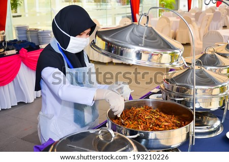 PUTRAJAYA, MALAYSIA - MAR 3:Environmental Health Office sampling food for law requirement on Mar 3, 2014 in Putrajaya. Sampling is necessary to ensure food is not contaminated with microbiology. - stock photo