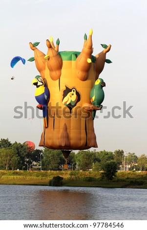 PUTRAJAYA, MALAYSIA-MAR 16: Gary Moore (USA) with Woodrow C. Greenleaf balloon in flight at the 4th Putrajaya International Hot Air Balloon Fiesta Mar 16, 2012 in Putrajaya. - stock photo