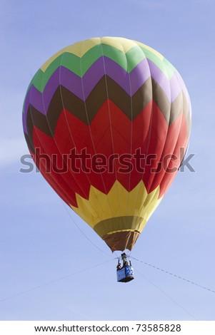PUTRAJAYA, MALAYSIA-MAR 20:Hot air balloon in flight at the 3rd Putrajaya International Hot Air Balloon Fiesta on 20 Mar, 2011 in Putrajaya.29 balloon from 13 countries participate in this year event. - stock photo
