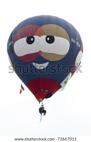 PUTRAJAYA, MALAYSIA-MAR 19:Hot air balloon in flight at the 3rd Putrajaya International Hot Air Balloon Fiesta on 19 Mar, 2011 in Putrajaya.29 balloon from 13 countries participate in this year event. - stock photo