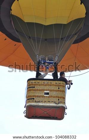 PUTRAJAYA, MALAYSIA-MAR 15: Hot air balloon in flight at the 4th Putrajaya International Hot Air Balloon Fiesta 15 Mar, 2012 in Putrajaya. - stock photo