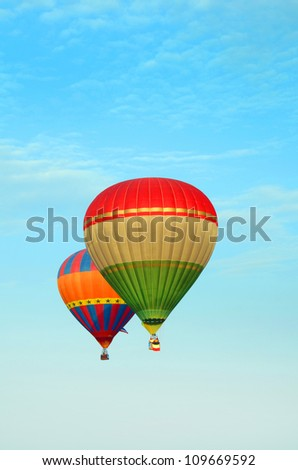 PUTRAJAYA, MALAYSIA-MAR 16: Hot air balloon in flight at the 4th Putrajaya International Hot Air Balloon Fiesta 16 Mar, 2012 in Putrajaya. - stock photo