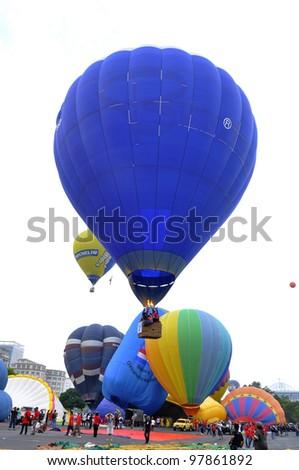 PUTRAJAYA, MALAYSIA-MAR 15: Hot air balloon in flight at the 4th Putrajaya International Hot Air Balloon Fiesta Mar 15, 2012 in Putrajaya.29 balloon from 13 countries participate in this year event - stock photo