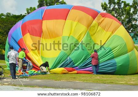 PUTRAJAYA, MALAYSIA-MAR 17: Hot air balloon is being shut down at the 4th Putrajaya International Hot Air Balloon Fiesta on Mar 17, 2012 Putrajaya. The event held in Precinct 2, Putrajaya, Malaysia. - stock photo