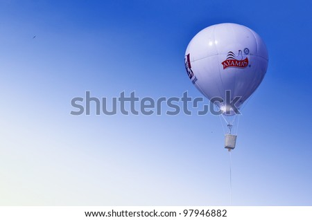 PUTRAJAYA, MALAYSIA-MAR 17: Replica of hot air balloon in flight at the 4th Putrajaya International Hot Air Balloon Fiesta 17 Mar, 2012 in Putrajaya. - stock photo
