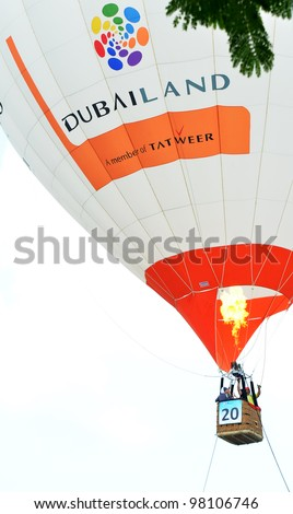 PUTRAJAYA, MALAYSIA-MAR 17:View of Dubai balloon at the 4th Putrajaya International Hot Air Balloon Fiesta on Mar 17, 2012 Putrajaya. The event held in Precinct 2, Putrajaya, Malaysia. - stock photo
