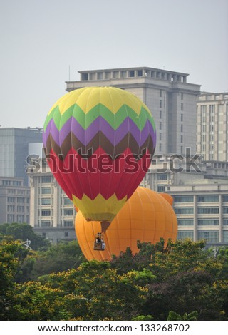 PUTRAJAYA, MALAYSIA - MARCH 29: A tethered hot air balloon floats on the air during 5th International Hot Air Balloon Fiesta at Presint 2, Putrajaya on March 29, 2013. - stock photo