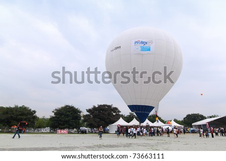 PUTRAJAYA, MALAYSIA - MARCH 19: Britain hot air balloon prepare to takeoff in the morning sky during 3rd Putrajaya International Hot Air Balloon Fiesta 2011 on 19 March, 2011 in Putrajaya, Malaysia. - stock photo