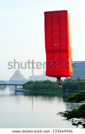 PUTRAJAYA, MALAYSIA-MARCH 19:Hot air balloon from Malaysia in flight at 5th Putrajaya International Hot Air Balloon Fiesta Mar 29, 2013 in Putrajaya.More than 250,000 people visit this yearly event - stock photo