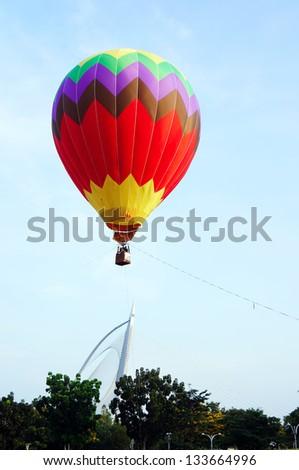 PUTRAJAYA, MALAYSIA-MARCH 29: Hot air balloon in flight at the 5th Putrajaya International Hot Air Balloon Fiesta 29 March, 2013 in Putrajaya. - stock photo